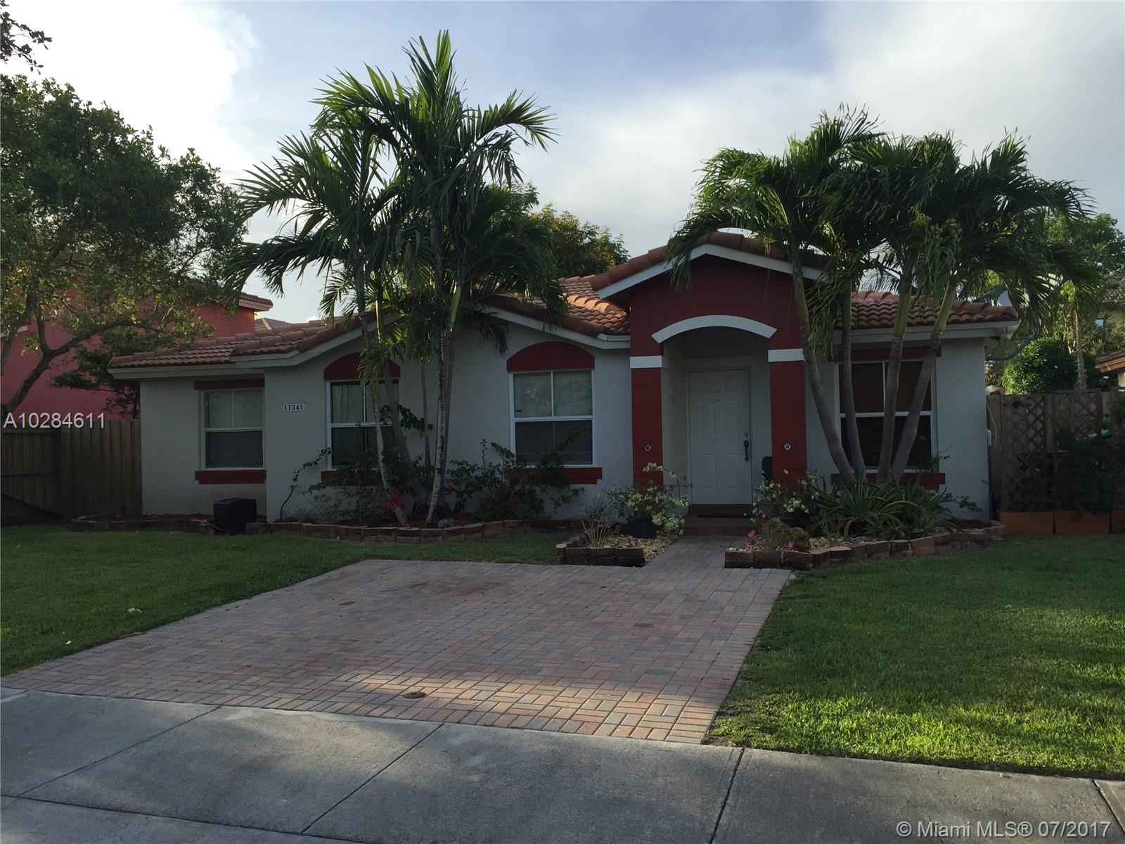 Very nicely kept and updated home in highly sought after Coconut Palm area